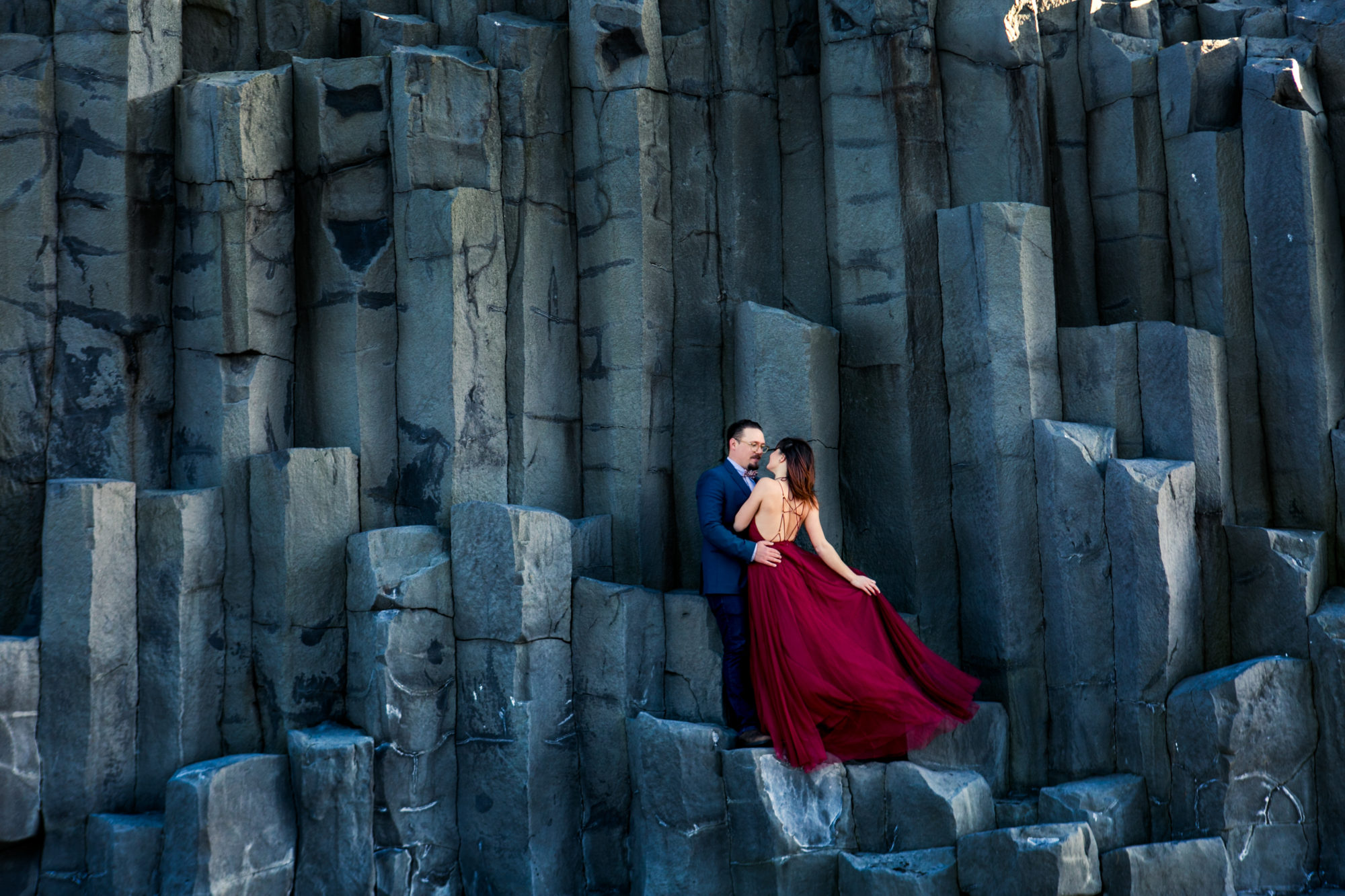 Red Dress Engagement Blue Suit Reynesfjara Vik Iceland Black Sand Beach Zsuzsi Pal Photography