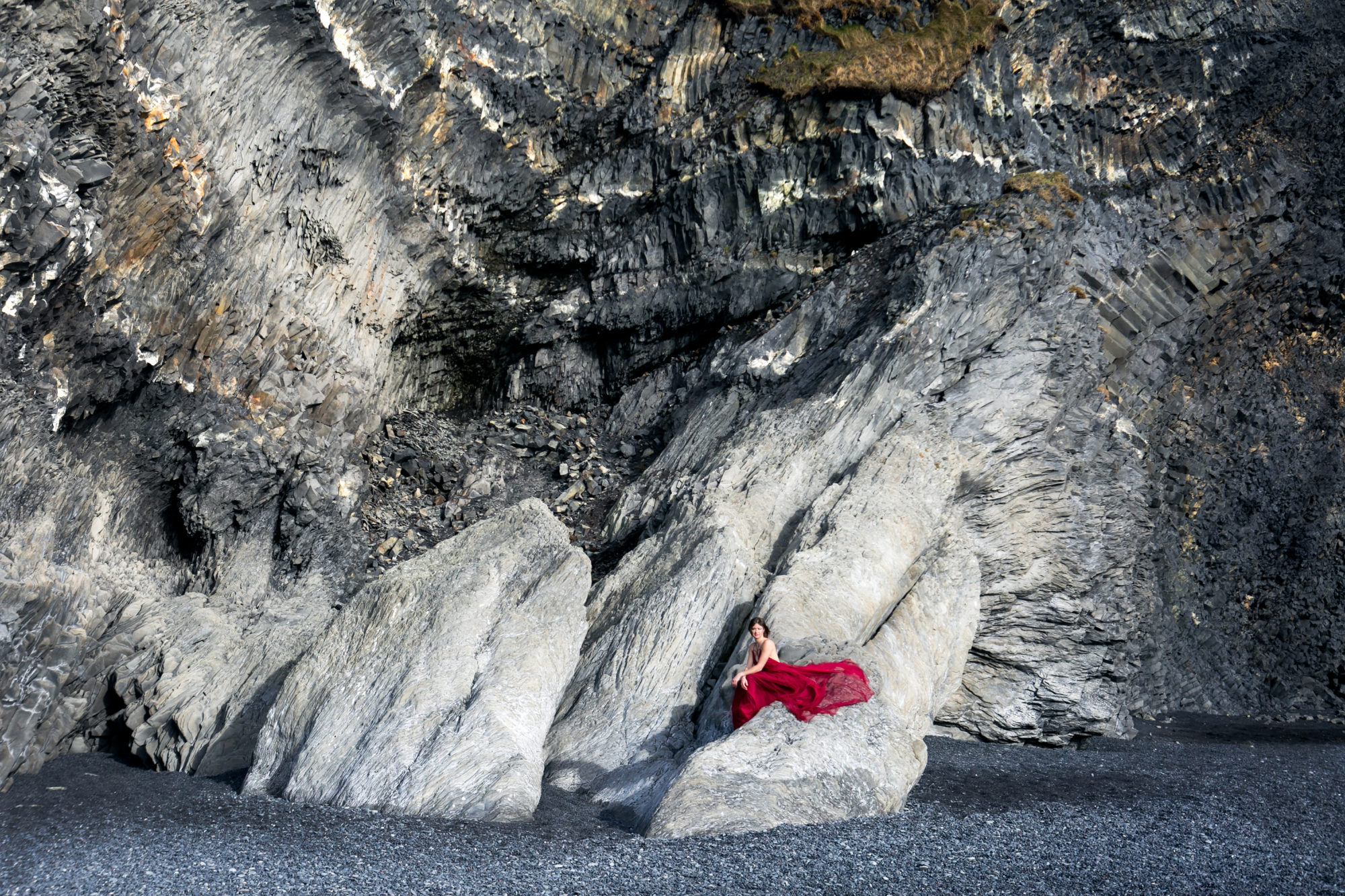 Red Dress Sitting Reynesfjara Vik Iceland Black Sand Beach Zsuzsi Pal Photography
